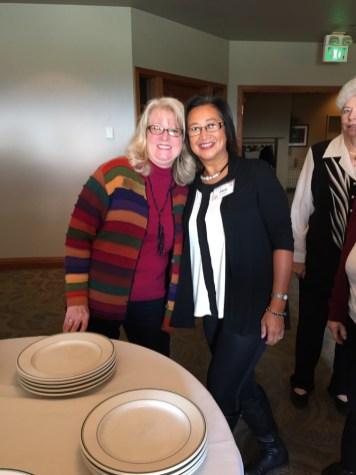 Gayle Schanck and Aleli Lawson share a big smile as they approach the food table.