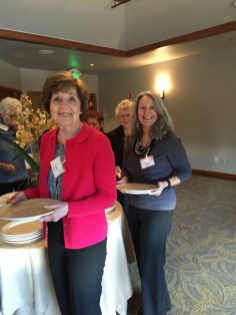 Jeanne Wood and Barbara Young share a smile in the buffet line.