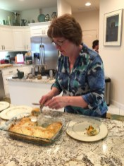 Betsy Hase serves the butternut squash lasagne that she prepared