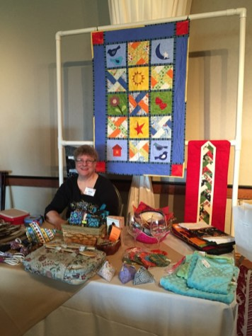 Dora Moore staffs a table for the Knotty Ladies