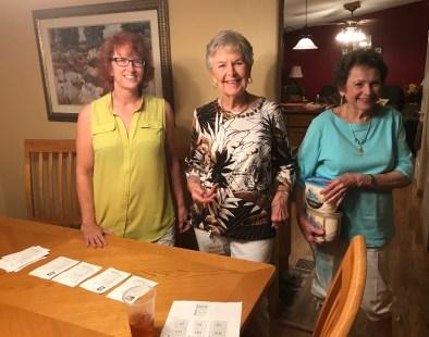 Annette Foster, Marcia McIntyre, Ida Tolmie with scorecards & dessert