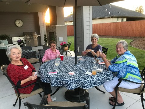 Enjoying the warm evening on the patio with friends & cards