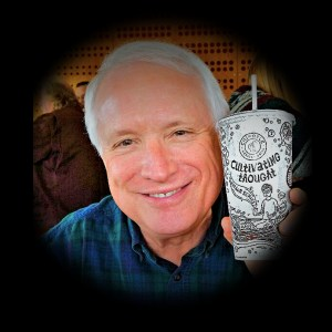 """Dr. Dana Ackley holds up a cup from Chipotle which reads """"Cultivating thought"""""""