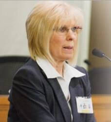 Photo of Dr. Karin Huffer speaking in court
