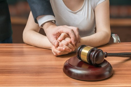 Advocate holding the hands of the client
