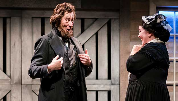 """Robert Gallaher and Marianne Savell in """"A Civil War Christmas: An American Musical Celebration"""" at Taproot Theatre. Photo by Robert Wade."""