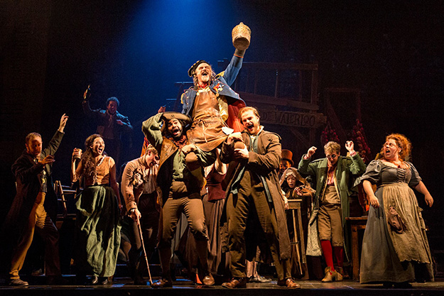 """The company of LES MISÉRABLES performs """"Master of the House"""" with J Anthony Crane as 'Thénardier' and Allison Guinn as 'Madame Thénardier.' (Photo by Matthew Murphy)"""