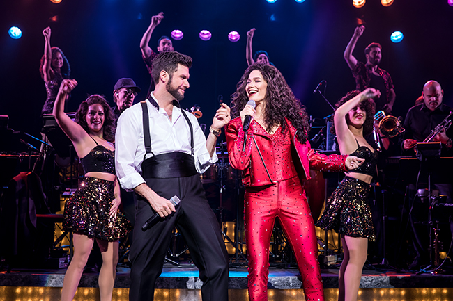 Mauricio Martinez as Emilio Estefan and Christie Prades as Gloria Estefan and Company, ON YOUR FEET! (photo © Matthew Murphy)