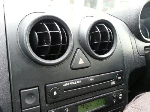 wpid 20131224 121528 - Faces in things - car dash board