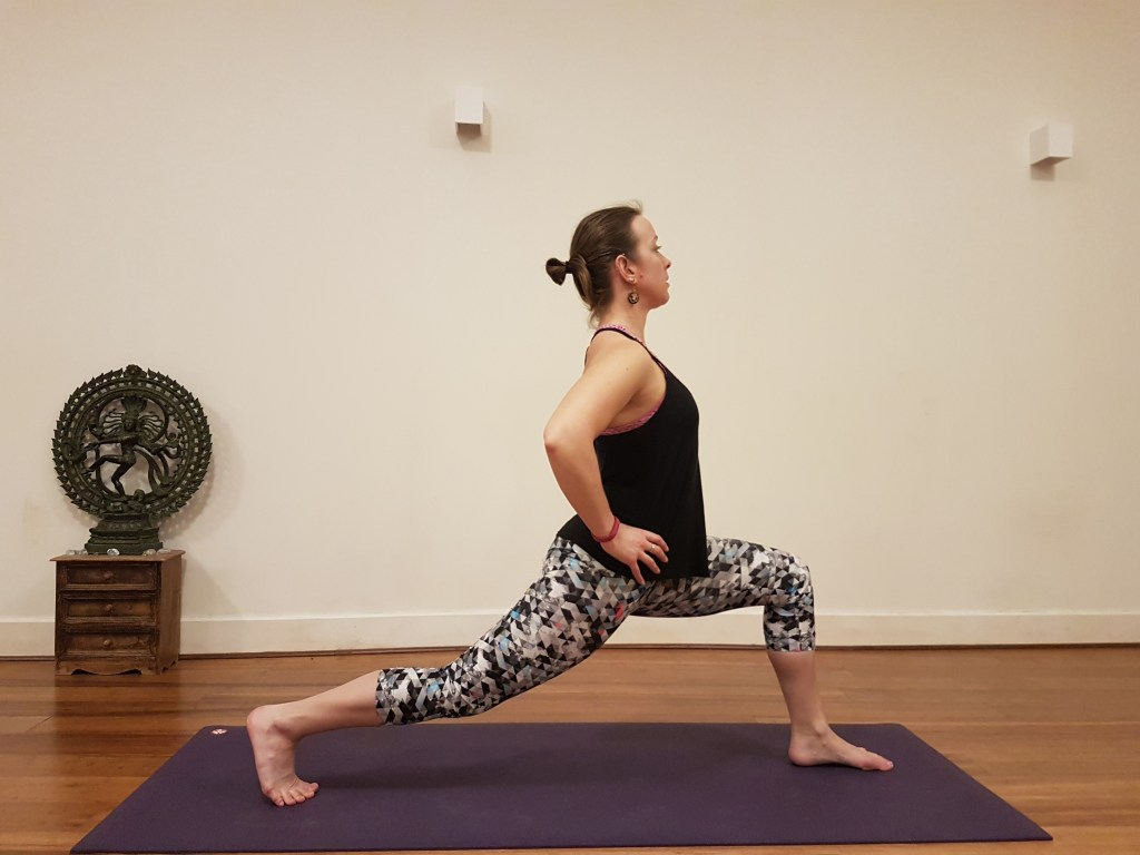 Crescent Lunge pose with hands on hips