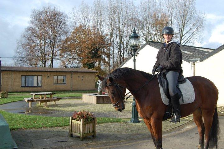 Krystal rides a horse in Belgium