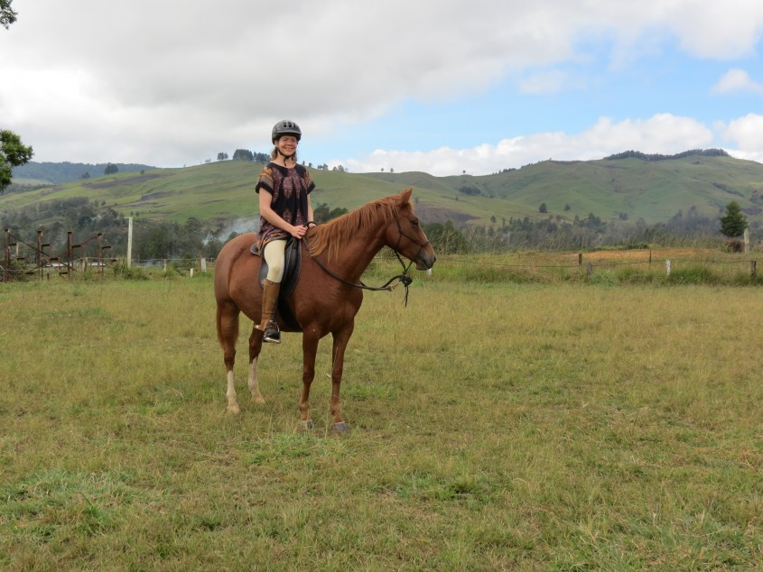 Riding her horse in 2017 in Papua New Guinea at the pony club