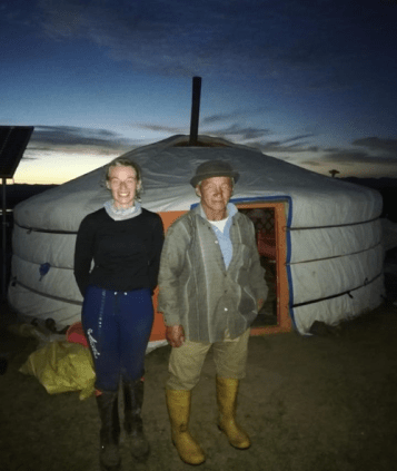 "A mongolian ""grandpa"" posing with hinke during the mongol derby when she spent the night between horse stations."