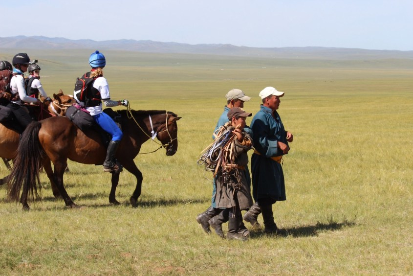 Herders in mongolia going to catch their horses at a horse station during the mongol derby