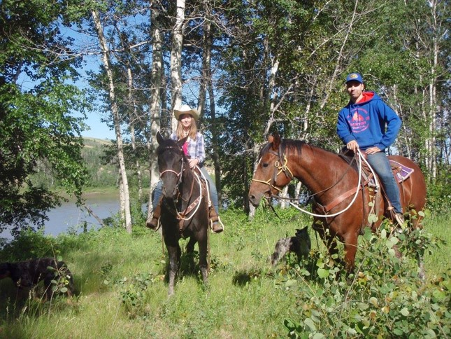 Dean and Jessica are trail riding in Canada with two horses
