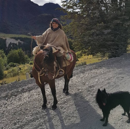 In full working outfit for daily chores in Patagonia. My great horse Malandrin, me and my dog Drako.