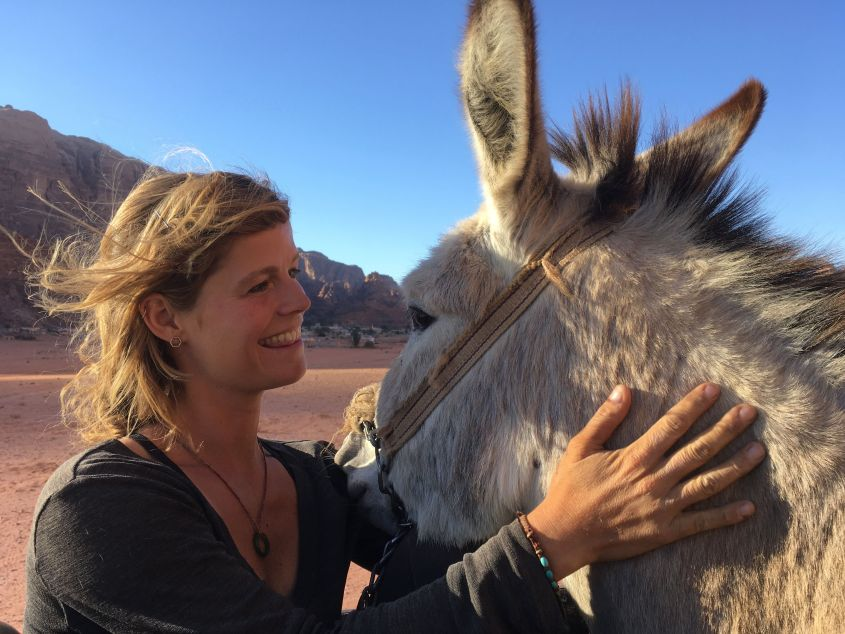 On the back of a truck with my Donkey in Jordan
