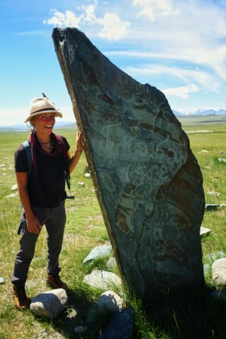Me next to an ancient deer stone in Mongolia