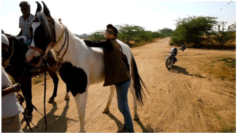 Enjoying a break during 500km bareback horse riding across Rajasthan