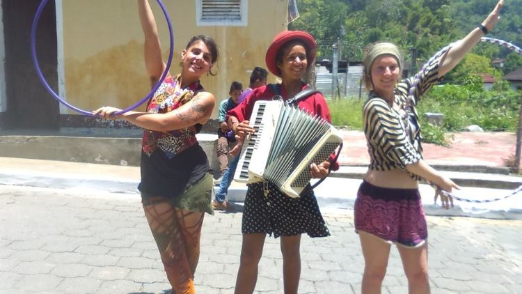 A photo taken after a circus performance. Hula Hoops and an accordion made up an attraction on this day in the market of Senahú, Guatemala