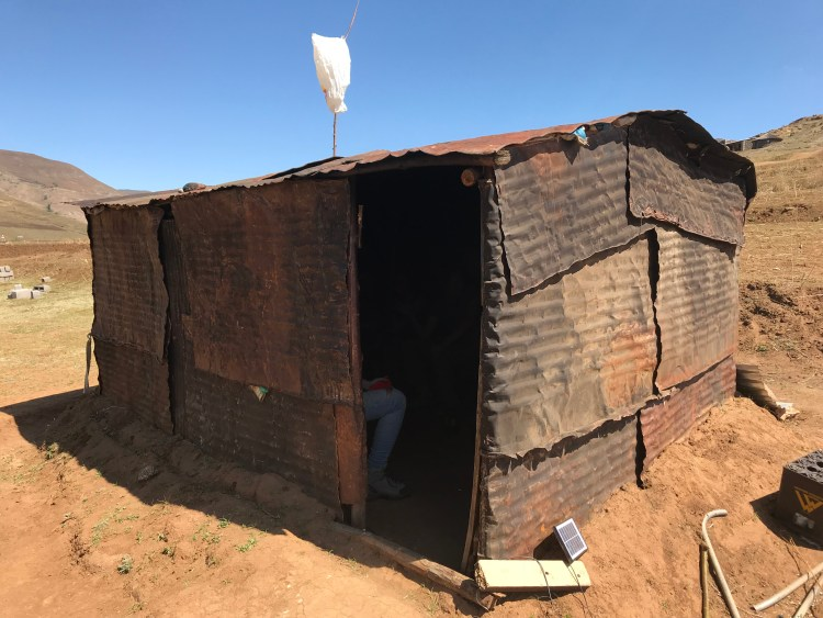 A local hut where we drank homemade maize beer. In Lesotho, the white bag on top of the pole next to the hut indicates that something is sold here.