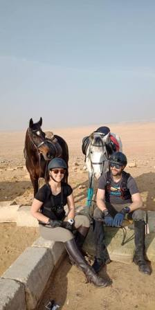 Two riders have a short break during horseback riding in Egypt in the desert near Cairo