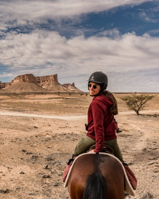 A woman who loves horses enjoys riding horses in Morocco