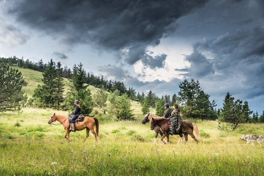 horse riders in Slovenia waiting for the storm to come