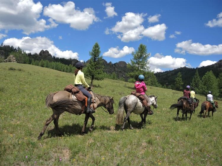 Horse riding in beautiful scenery in Gorkhi Terelj National Park, Mongolia