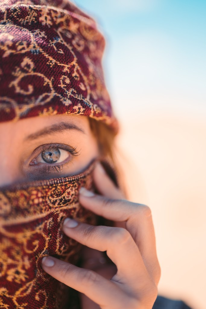 In Egypt most women cover their face. Even if you don't agree with it, it is part of their culture. Be respectful.