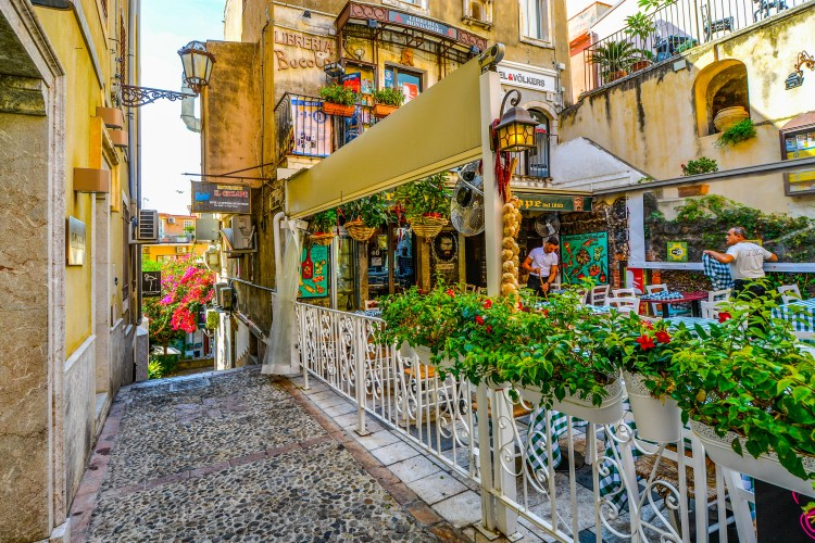 A colorful cafe in the streets of the Italian island of Sicily