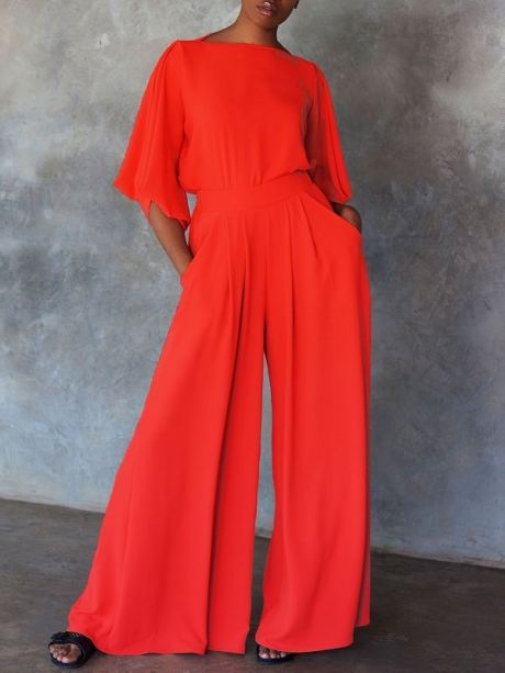 Red top and wide leg pants