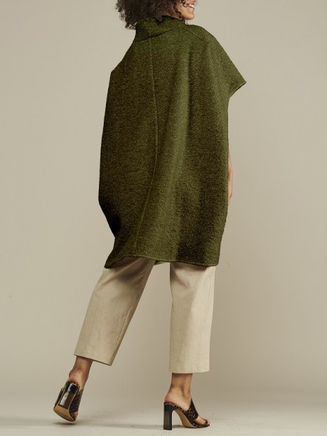 green cape jacket worn with beige pants made in South Africa
