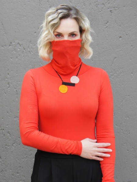 Woman wearing orange polo neck with built-in face mask South Africa