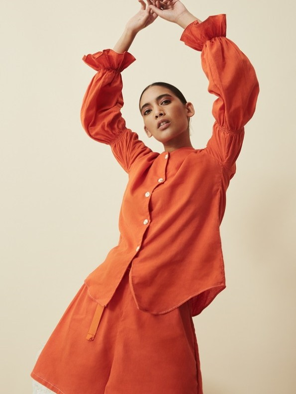 Asha Eleven Outlander Blouse Orange With Salama Shorts Arms Up