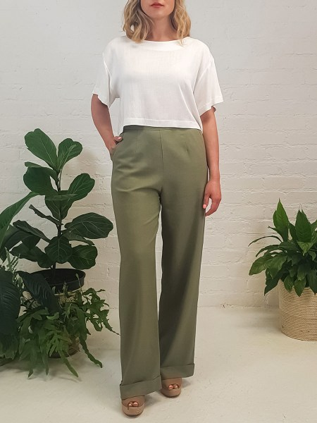 green linen pants with white top
