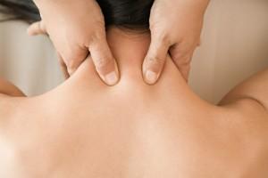 Woman having neck massaged