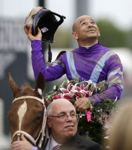 Jockey Mike Smith with owner Ed Stanco celebrate after Smith rode Princess of Sylmar to a win in the 139th Kentucky Oaks at Churchill Downs. (AP Photo/David Goldman)
