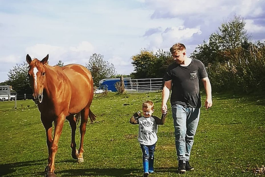 the boy and the bfg, introducing children to horses. Scottie walking with my parnter and his son.