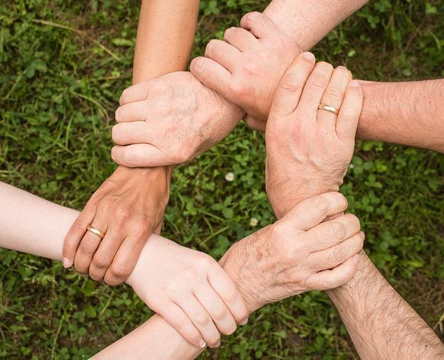 hands hold together shows team spirit