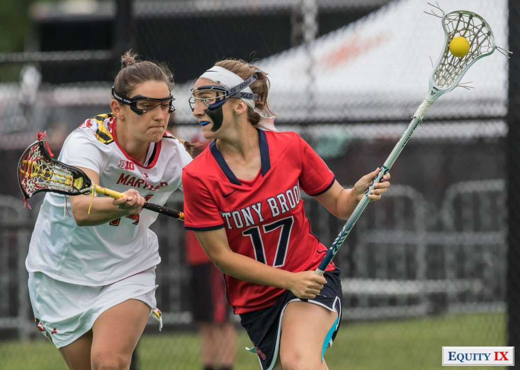 #17 Kylie Ohmiller (Stony Brook) with goggles and black face paint drives to goal with the ball left handed against #14 Nadine Hadnagy (Maryland) - 2017 NCAA Women's Lacrosse © Equity IX - SportsOgram - Leigh Ernst Friestedt