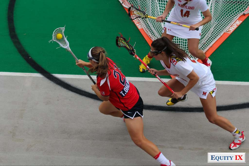#21 Taryn Ohlmiller (Stony Brook) drives around the crease against defender #24 Julia Braig (Maryland) at 2017 NCAA Women's Lacrosse Quarter Finals © Equity IX - SportsOgram - Leigh Ernst Friestedt