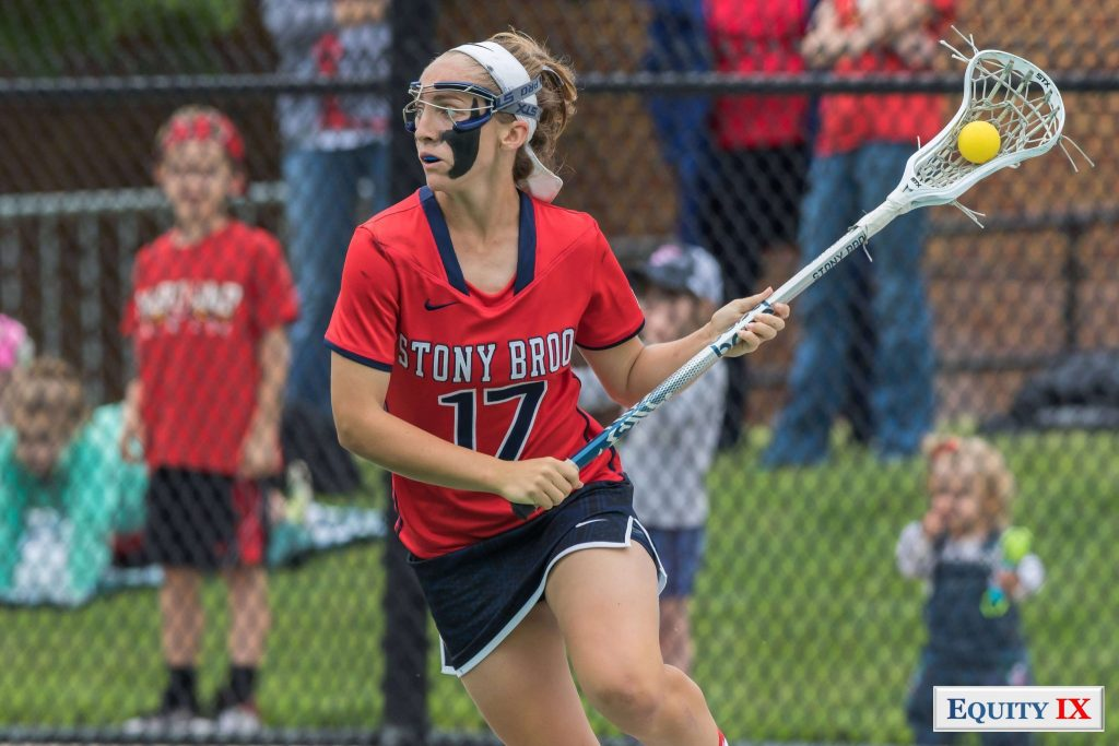 #17 Kylie Ohlmiller (Stony Brook) with goggles and black face paint drives to goal left handed at 2017 NCAA Women's Lacrosse Quarter Finals © Equity IX - SportsOgram - Leigh Ernst Friestedt - ZyGoSports
