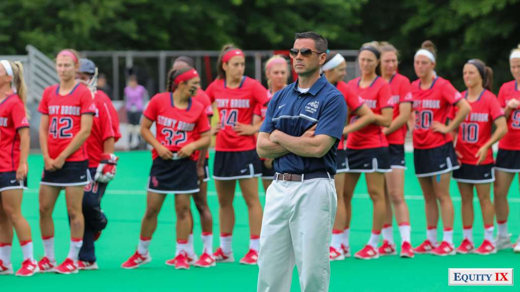Joe Spallina - Stony Brook Women's Lacrosse Head Coach stands in front of team for national anthem wearing sunglasses before game against Maryalnd- 2017 NCAA Women's Lacrosse © Equity IX - SportsOgram - Leigh Ernst Friestedt