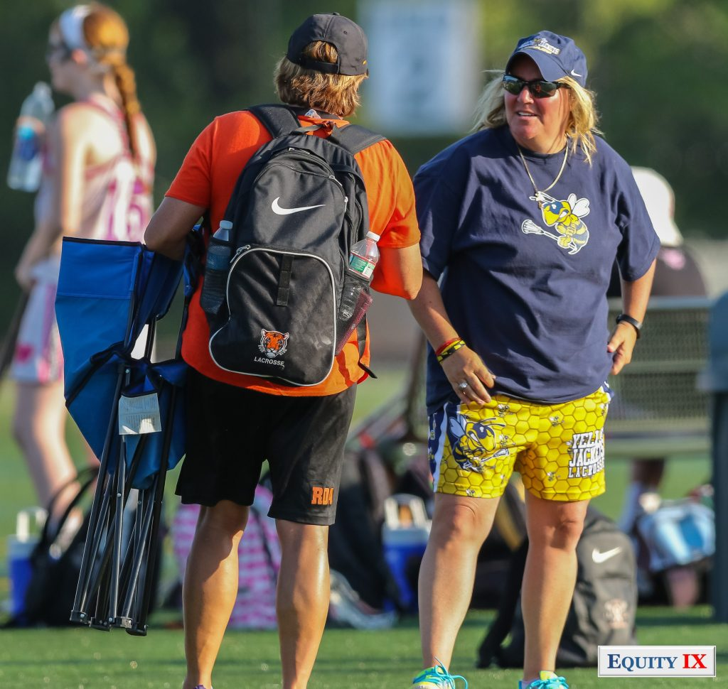 Chris Sailer - Princeton Women's Lacrosse Head Coach in orange and black speaks with Yellow Jackets girls club lacrosse coach in yellow and blue for early recruiting tournament -2015 Nike Elite G8 © Equity IX - SportsOgram - Leigh Ernst Friestedt