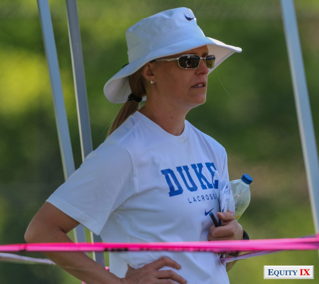 Kerstin Kimel - Duke Head Women's Lacrosse Coach watches early recruiting at 2015 Girls Club Lacrosse - Nike Elite G8 Tournament with hands on her hips, sunglasses, water bottle and Duke Lacrosse t-shirt © Equity IX - SportsOgram - Leigh Ernst Friestedt
