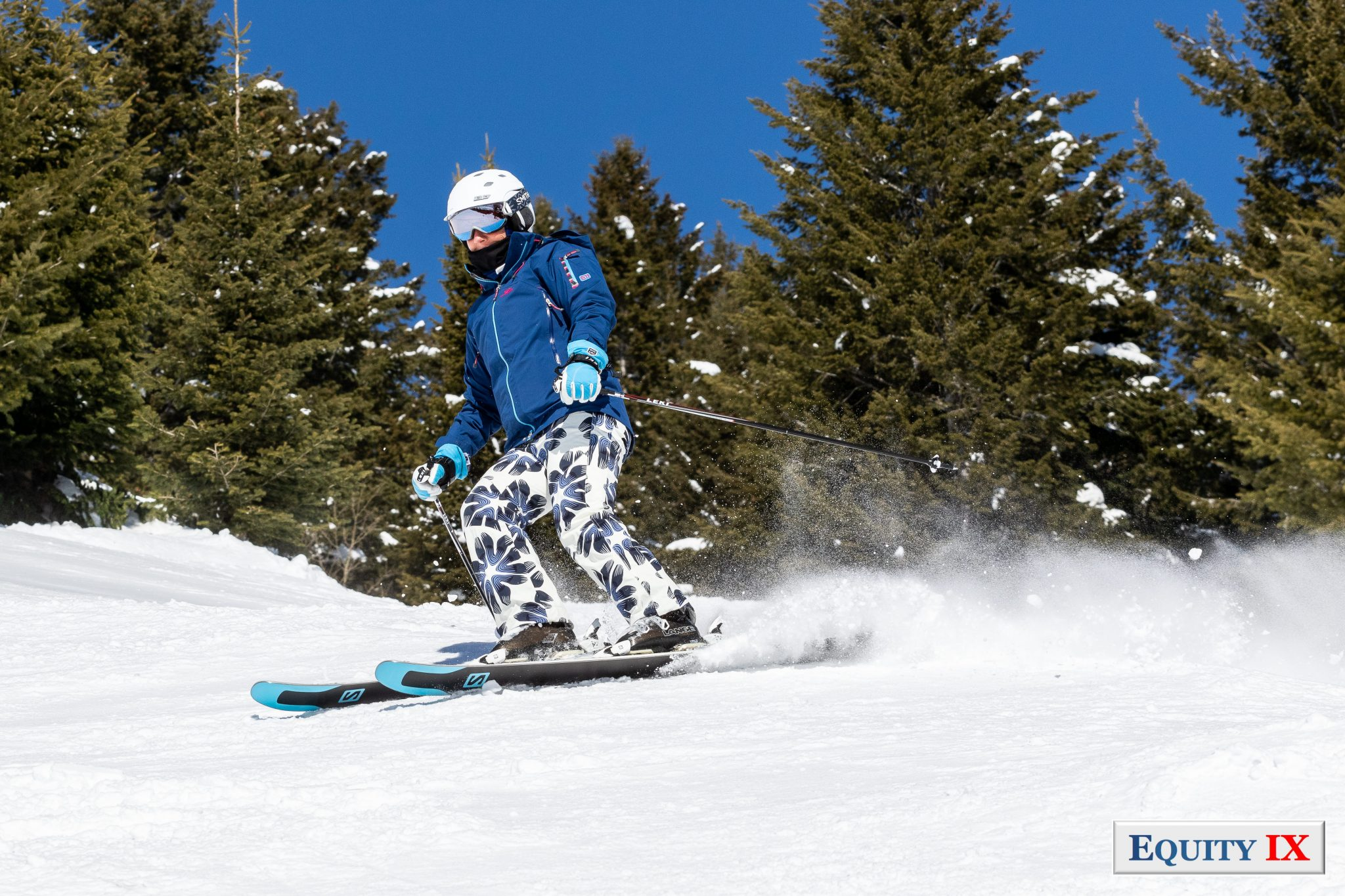 Leigh Ernst Friestedt skiing at Jackson Hole, WY 2018 in blue outfit with white helmet © Equity IX - SportsOgram