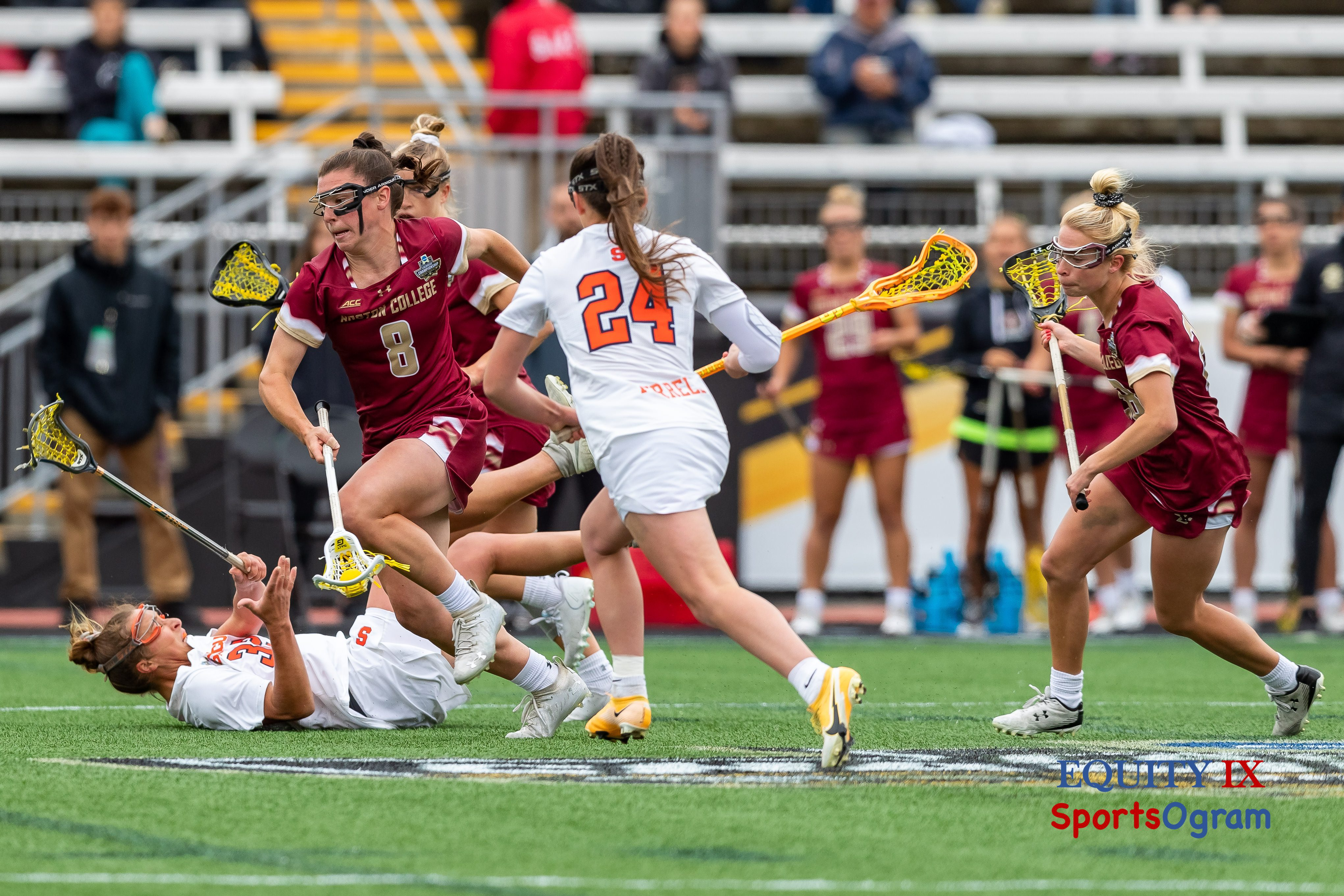 #8 Charlotte North (Boston College) runs through the midfield with yellow lacrosse ball in stick after winning the draw against Syracuse with one player on the ground and #24 chasing Charlotte - 2021 NCAA Women's Lacrosse Championship Game © Equity IX - SportsOgram - Leigh Ernst Friestedt