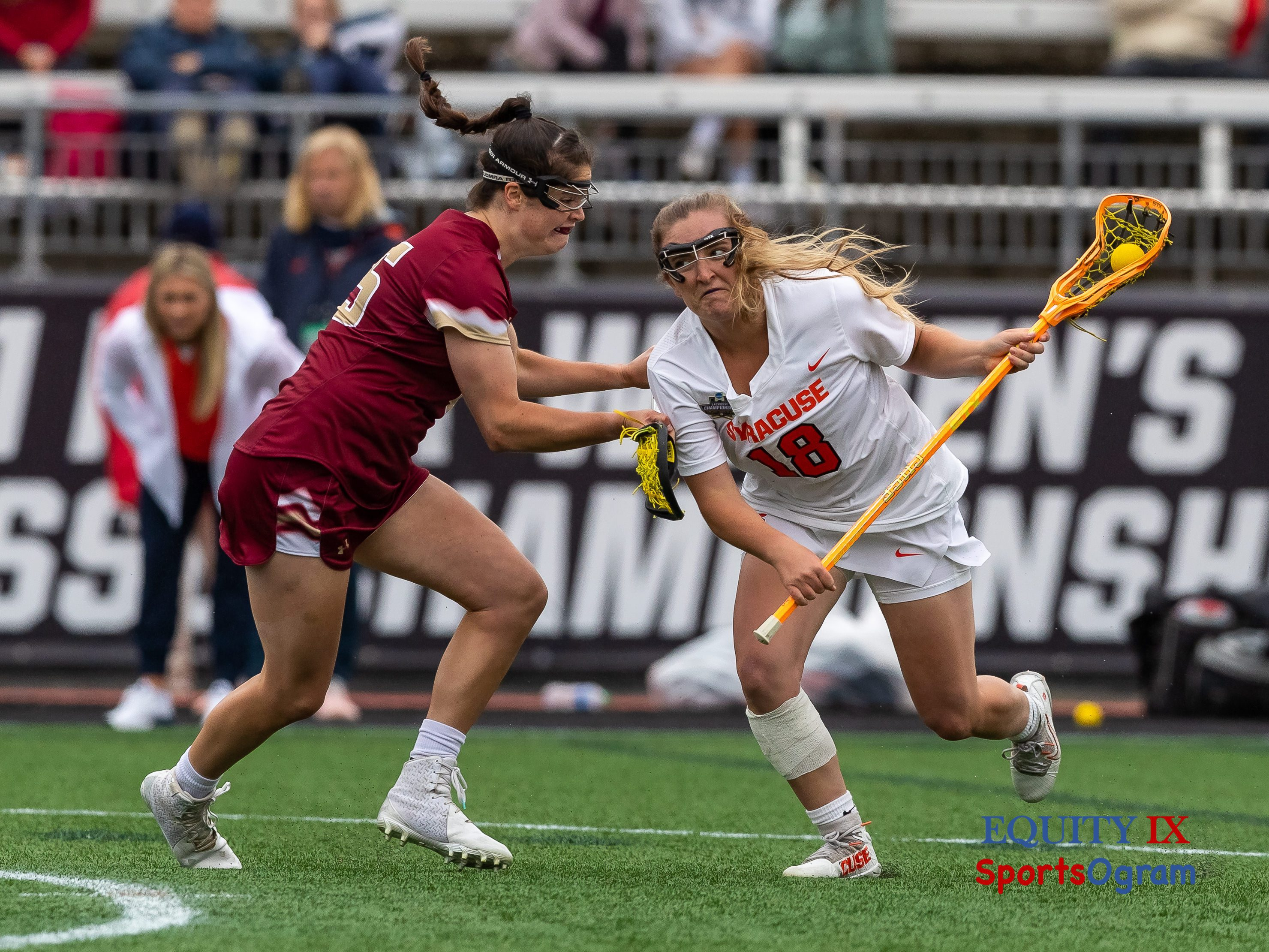 #18 Meaghan Tyrrell (Syracuse) drives to goal left handed with a bandage around her right calf against #45 Sydney Scales (Boston College) - 2021 NCAA Women's Lacrosse Championship Game © Equity IX - SportsOgram - Leigh Ernst Friestedt