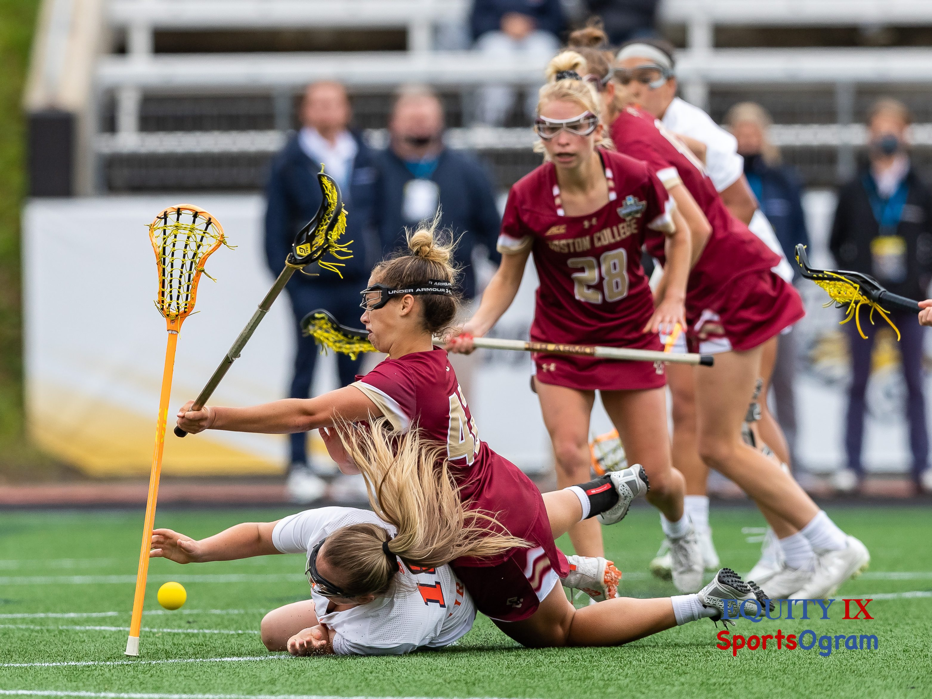 #42 Hunter Roman (Boston College) falls on top of #18 Meaghan Tyrrell (Syracuse) at the goal line of the crease both lacrosse sticks falling out of their hands and the yellow lacrosse ball bouncing in the crease - 2021 NCAA Women's Lacrosse National Championship © Equity IX - SportsOgram - Leigh Ernst Friestedt